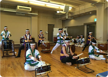 Photo from a research trip: Genryu Daiko from Brazil and Akasun Taiko Team from Argentina perform at the Kobe Migration Museum and Cultural Center.
